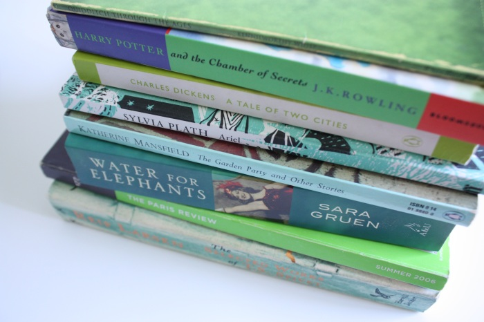 a stack of green books