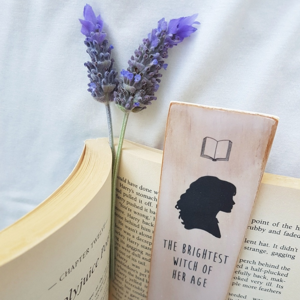 Lavender sprigs and a wooden bookmark in the middle of a book