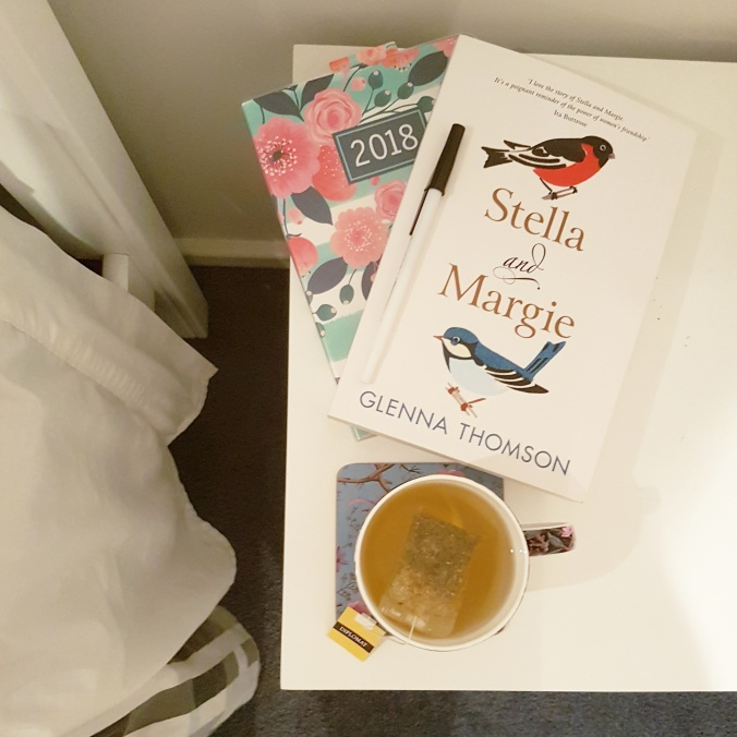 Stella and Margie on a bedside table beside a cup of tea