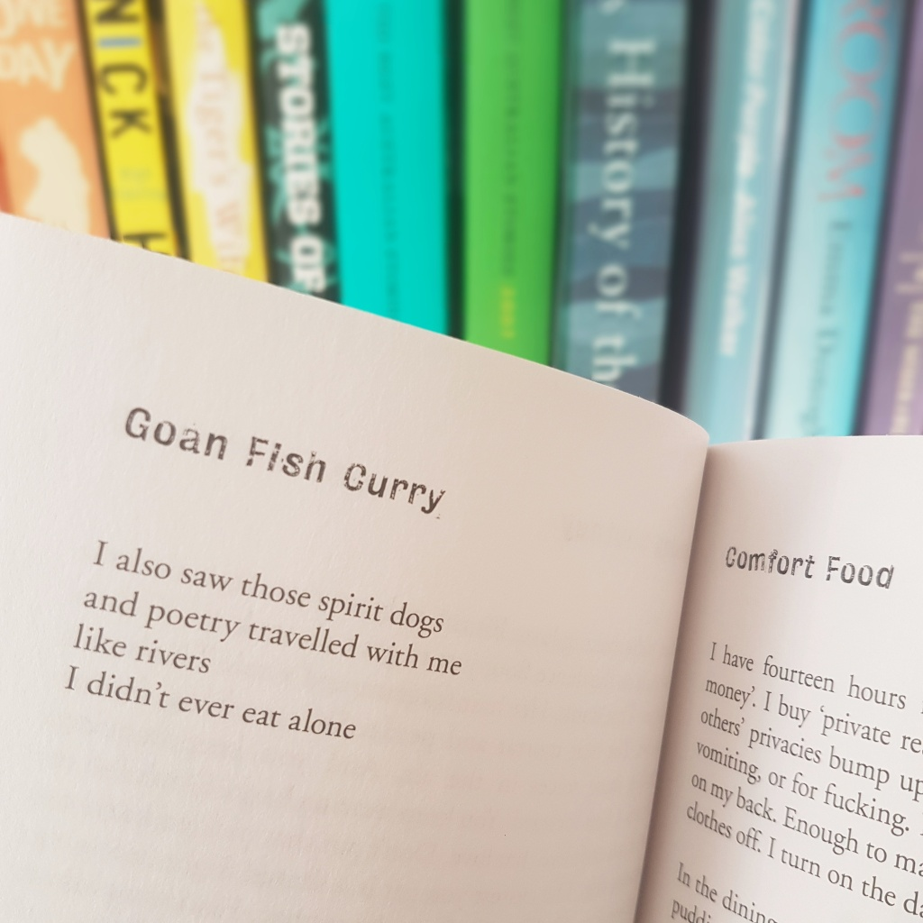Poetry from Comfort Food against a colourful bookshelf
